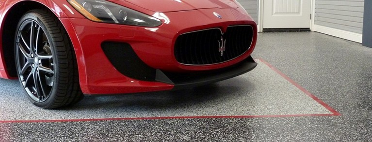 Maserati on Epoxy Garage Floor Coating System Designed by Garage Concepts, LLC